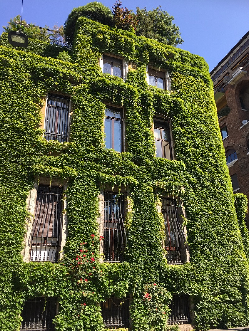 multi level building covered in greenery called villa mozart in milan
